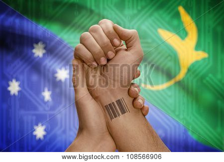 Barcode Id Number On Wrist Of Dark Skinned Person And National Flag On Background - Christmas Island