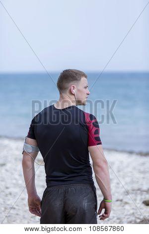 Male Runner On The Beach
