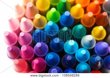 Colorful crayon tips close-up. Shallow depth of field.