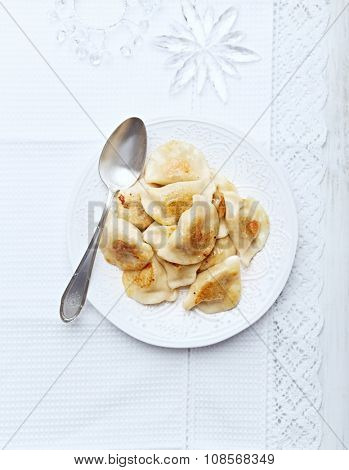 Pierogi with sour cabbage and mushrooms for Christmas (Polish cuisine)