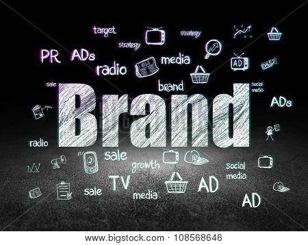 Advertising concept: Brand in grunge dark room