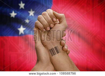 Barcode Id Number On Wrist Of Dark Skinned Person And National Flag On Background - Samoa