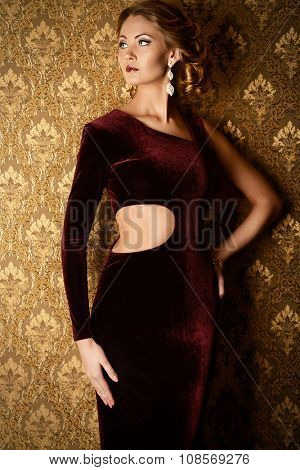 Elegant young woman in  evening dress posing in vintage interior. Jewellery.  Fashion shot.