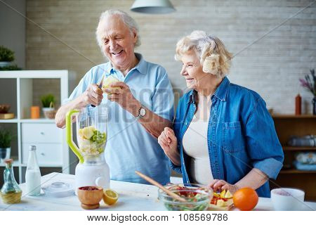 Senior man and his wife going to make smoothie from fresh fruits