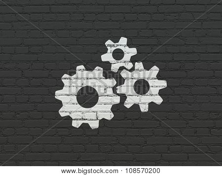 Marketing concept: Gears on wall background
