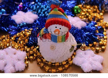 The white snowman on a background of festive decorations and ornaments.?hristmas toys