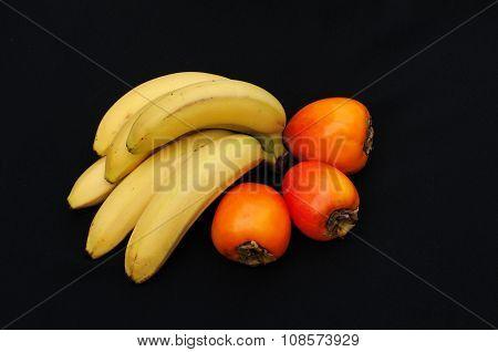 Fresh fruits on black background. Summer background. Raw and vegetarian eating background. pomegrana