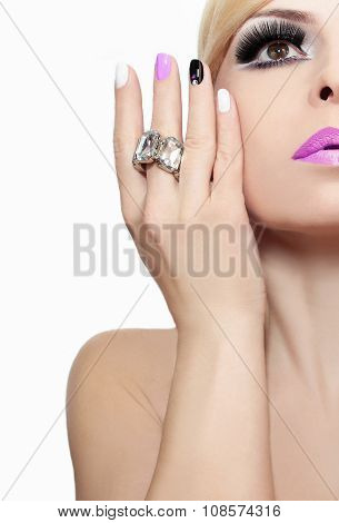 Makeup with pink lips and nail Polish.