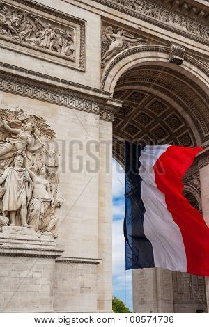 Detail Of Triumphal Arch With National Flag Of France, Paris, France