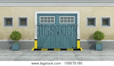 Old Facade With Blue Car Wooden Garage