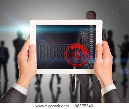 Businessman holding tablet with x-ray
