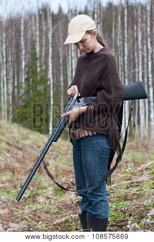 Woman Hunter Loading Shotgun On The Hunting