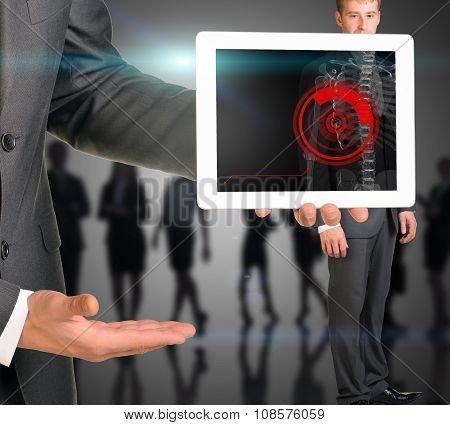Businessman holding tablet with x-ray of mans body