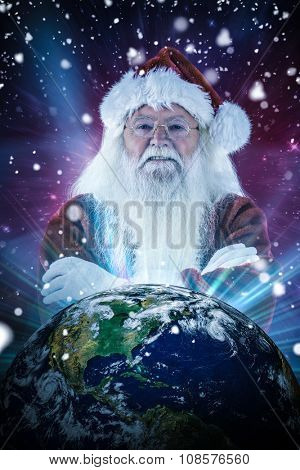Santa smiles with folded arms against outer space