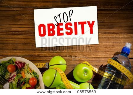 Stop obesity against indicators of healthy lifestyle on wooden table