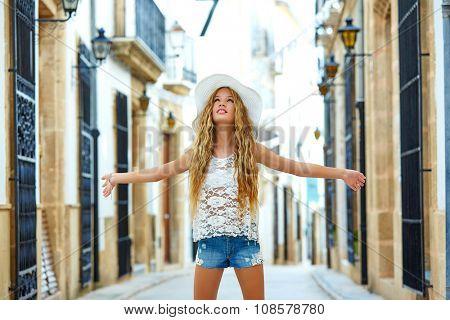 Blond tourist girl in mediterranean old town of Spain