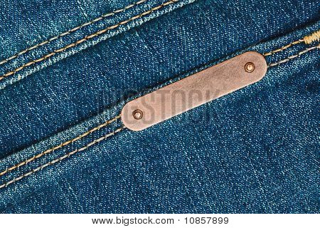 Bronze Metal Label On Jeans