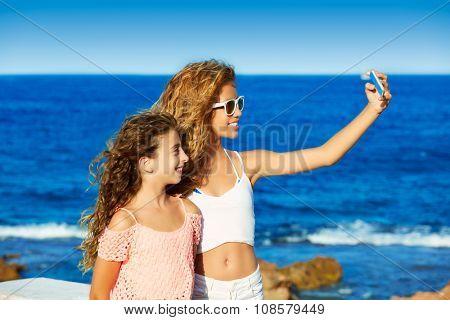 kid teen friend girls photo selfie on smartphone in a each at Mediterranean