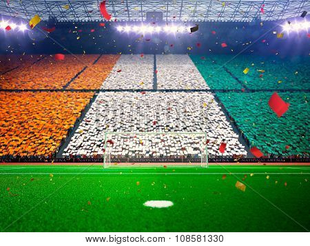 Flag Ivory Coast of fans. Evening stadium arena Blue