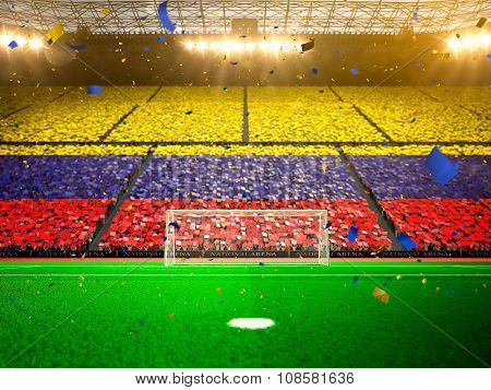 Flag Colombia of fans. Evening stadium arena