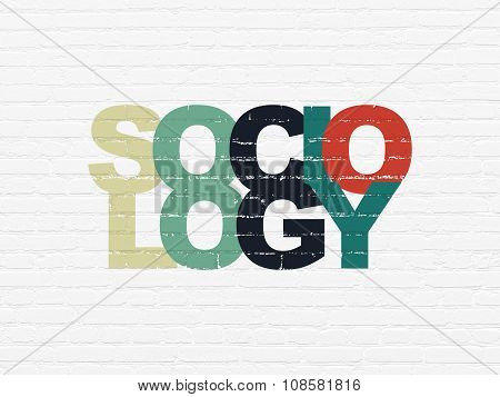 Education concept: Sociology on wall background