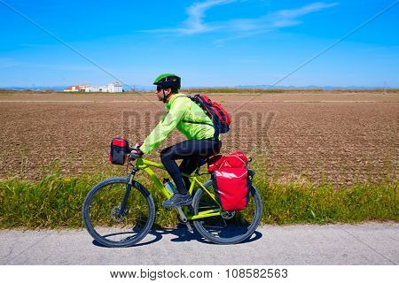 MTB Biker Bicycle touring with pannier racks and saddlebag