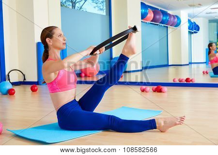 Pilates woman scissor magic ring exercise workout at gym indoor