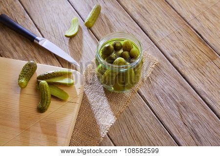 bottled pickles cucumbers in vintage wooden table