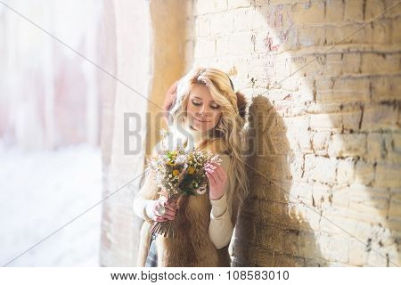 Portrait Of Beautiful Blond Woman With Flowers