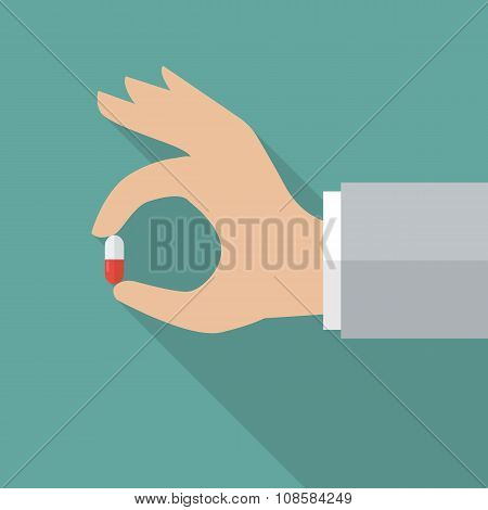 Hand Holding Medical Pill