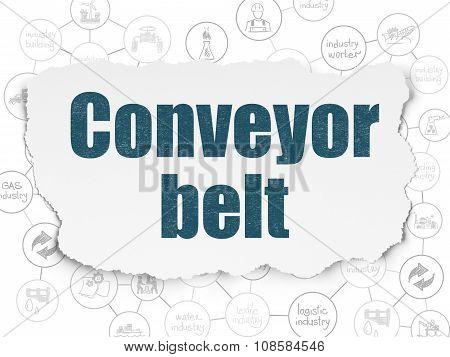 Manufacuring concept: Conveyor Belt on Torn Paper background