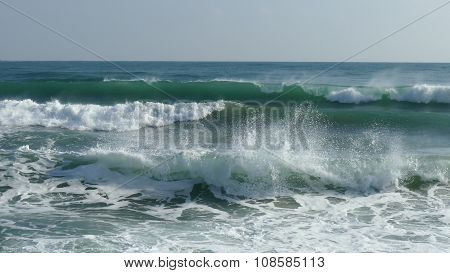 Splashing Waves In The Sea And Clear Sky