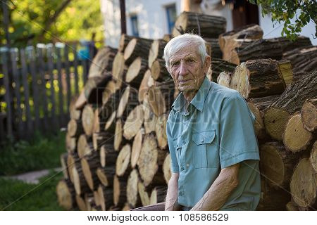Senior Man Near His House