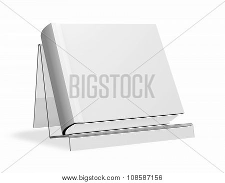 Square Book With Hard Cover Standing On Promotional Shelf.
