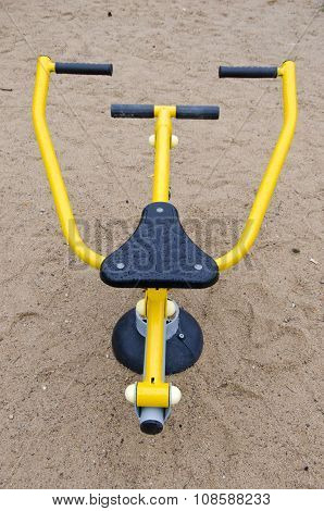 Black And Yellow Exercise Equipment In Playground