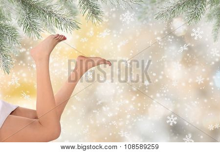 woman legs with christmas background