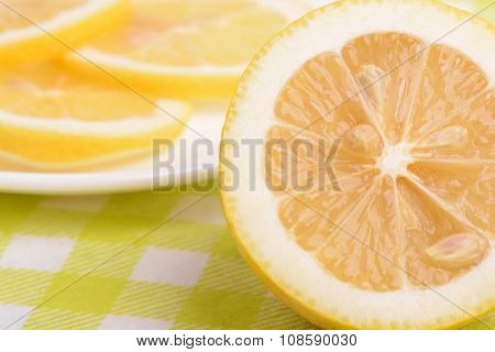 Background Of Yellow Ripe Lemons. A Slice Of Lemon.