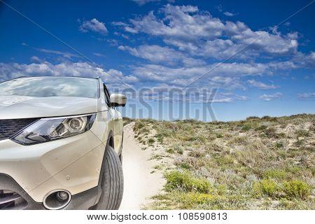 car in the beach dunes
