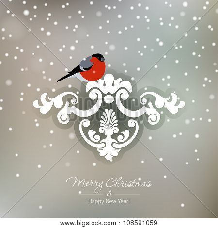 Red bullfinch on a snowy Christmas background