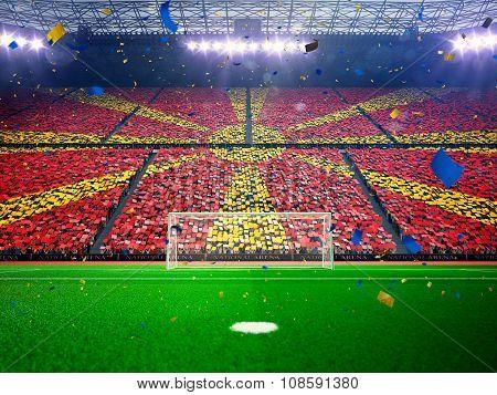 Flag Macedonia of fans. Evening stadium arena Blue