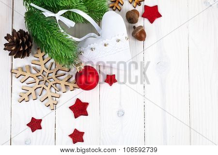 Christmas fir with balls and snowflake on wooden board