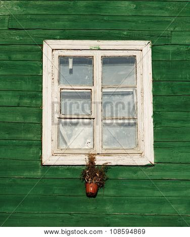 One window in vintage style in green wall background,architecture details. Colorful window fragment.