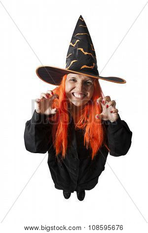 Brazilian woman wearing a Haloween costume - Witch casting spell on - isolated on white background.
