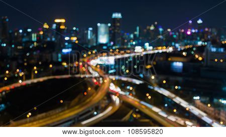 Abstract blurred bokeh lights, city night road intersection at night