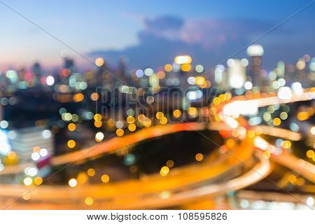 Blurred bokeh city downtown highway interchanged