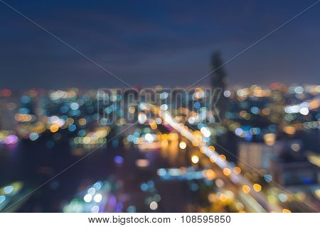 Abstract blurred bokeh light city downtown with bridge cross river