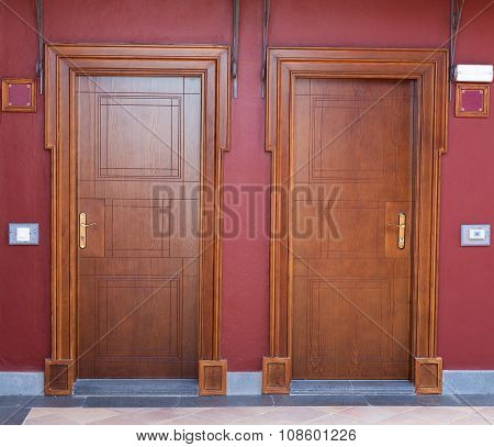 Two Wooden Doors Of The Hotel.