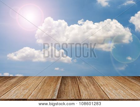 Wood Table Top On Blue Sky & Cloud Background