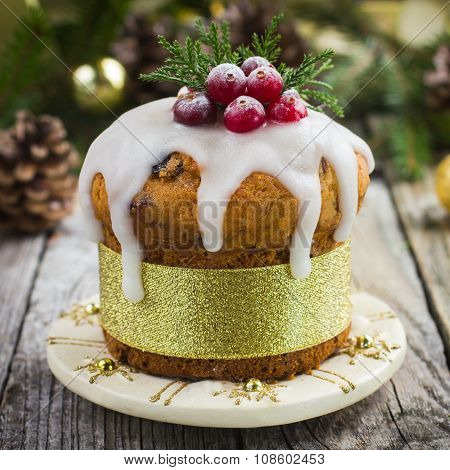 Christmas Fruit Cake Decorated With Icing And Berries