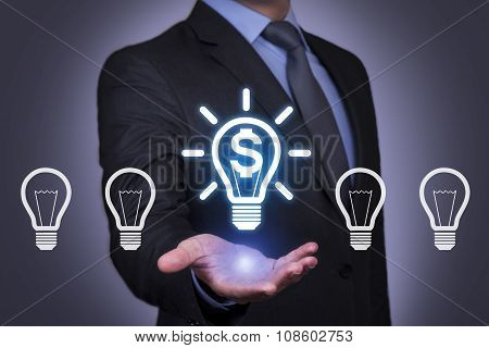 Businessman Holding his Hand Above the Finance Idea Bulb